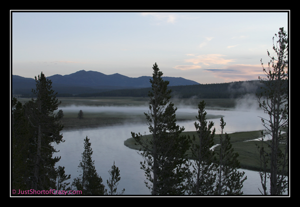 fog rising off a river at yellowstone national park