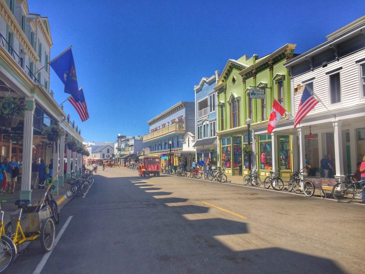 downtown Mackinac Island where the street is lined with colorful historic buildings that are now shops and restaurants