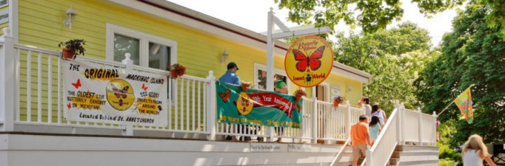 outside the butterfly house, a yellow one story building, on Mackinac Island