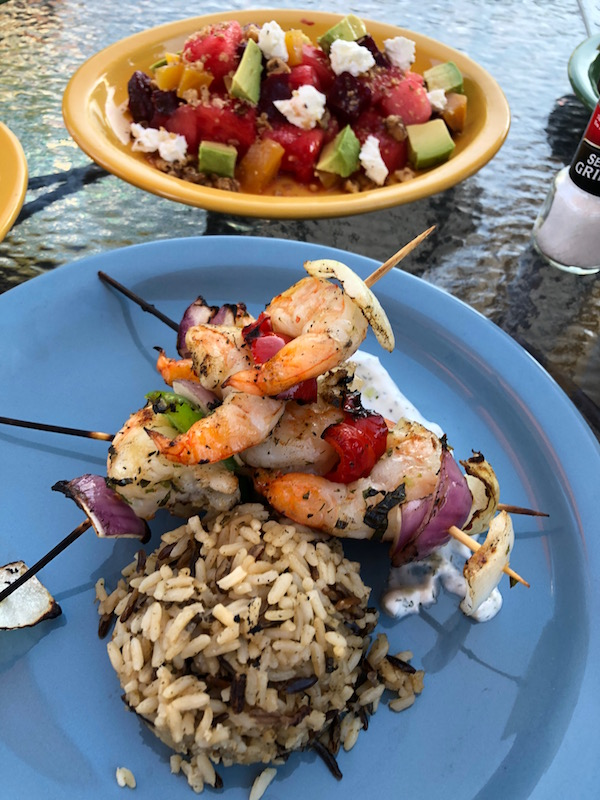 Wild rice served with grilled shrimp on skewers on Mackinac Island Hotels Mission Point Resort