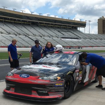 getting in a nascar race car at atlanta motor speedway