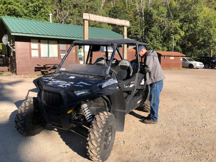 Alan standing next to UTV rented from Spearfish Canyon Lodge