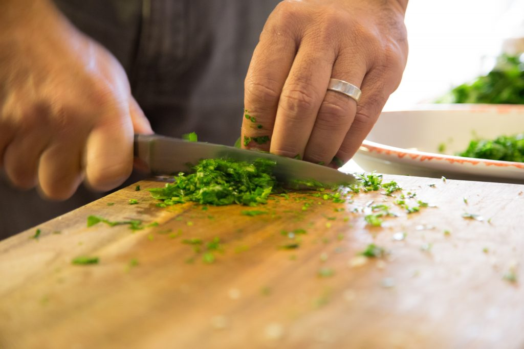 Canva - Cutting Herbs on the Board