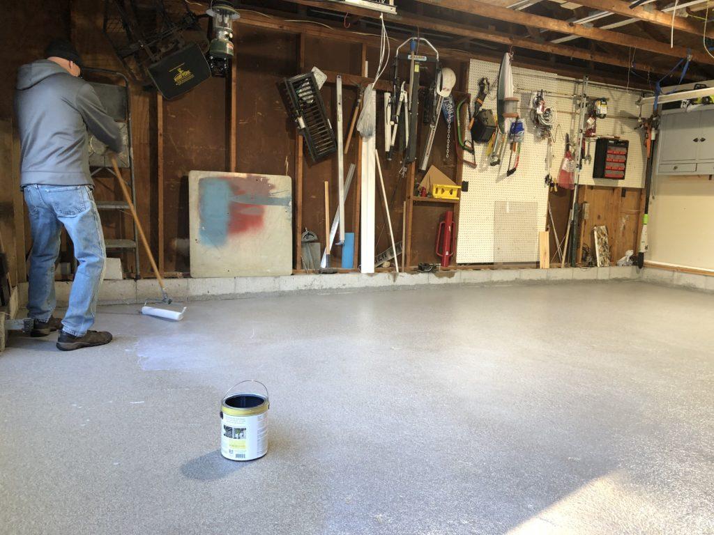 Anti slip sealer being painted on the floor