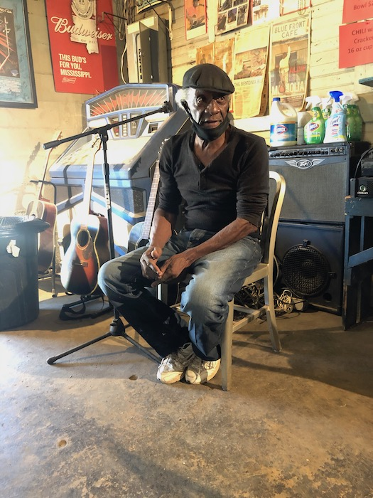 Jimmie Duck Holmes sitting inside the Blue Front Cafe