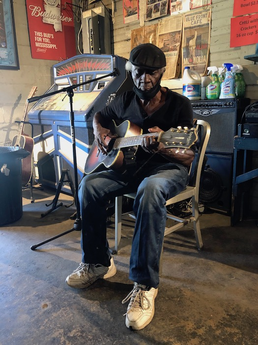 Jimmie Holmes Playing Guitar