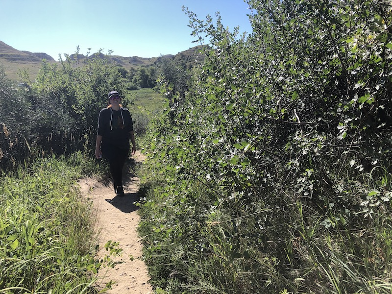 woman hiking a trail at wind canyon national park