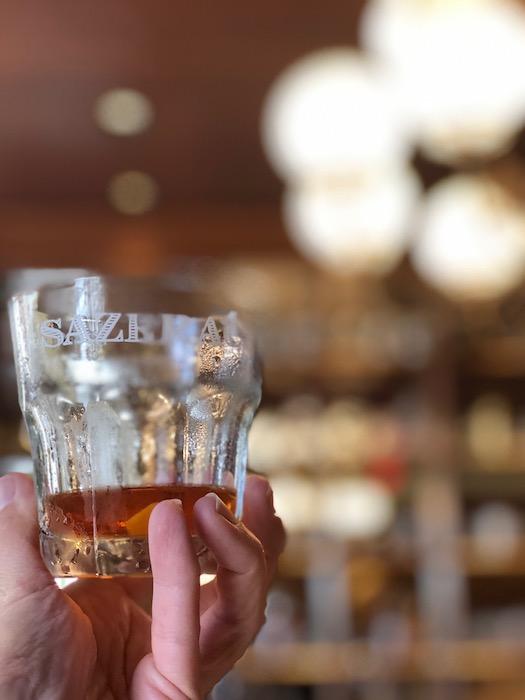 bartender shaking up some famous cocktails