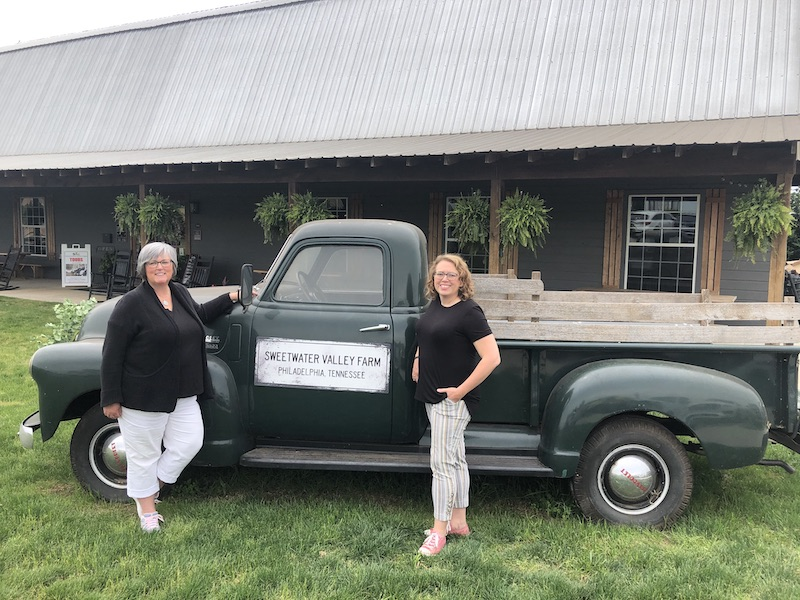 Laura and I standing in front of the vintage sweetwater valley farm truck