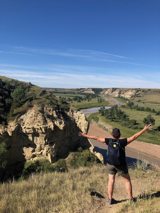 woman looking at the little missouri river on the wind canyon trail