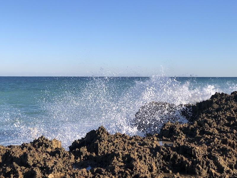 Waves crashing on the rocks along the atlantic coastline in martin county florida