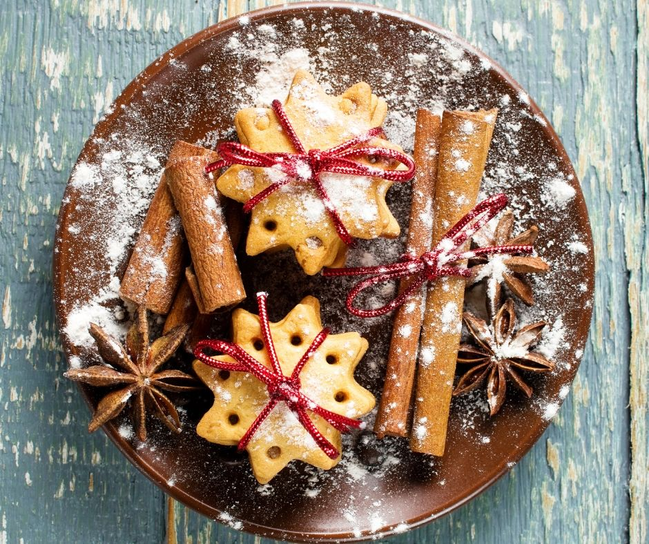 snowflake christmas cookies and cinnamon sticks