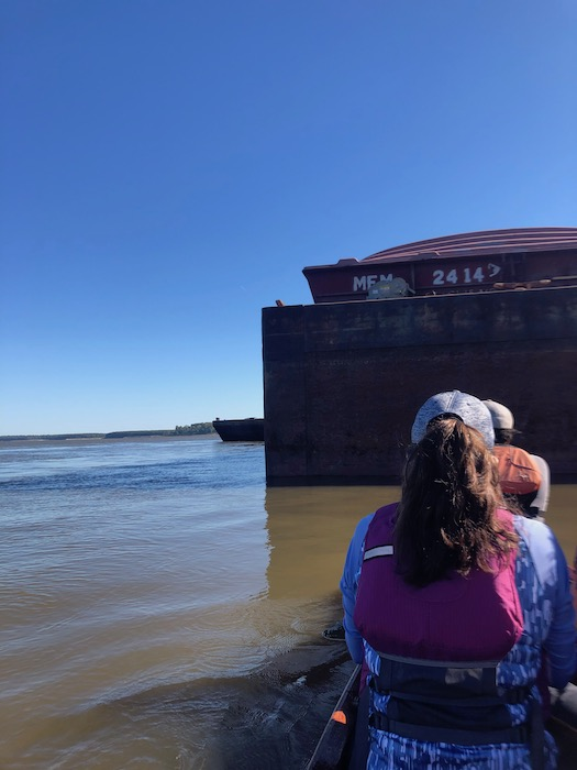 passing a parked barge on the mississippi river