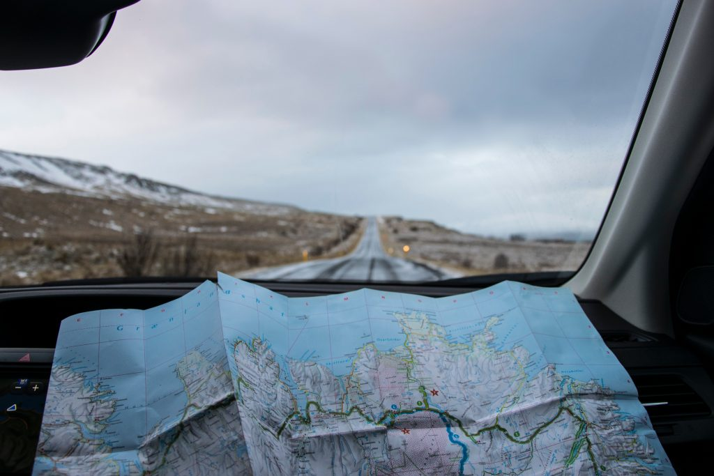 budget road trip guide using a map