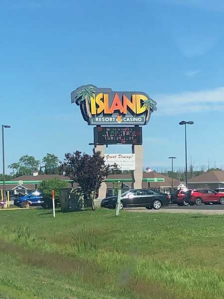 the island resort sign